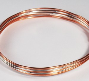 Copper bracelet with silver knots
