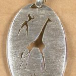 Larger oval pendant with giraffe, bushman and buck