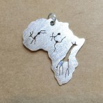 Africa pendant with giraffe bushman buck