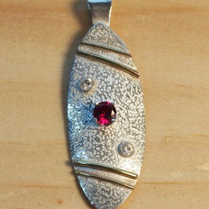 Silver shield with gold and ruby and diamonds