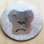 Silver lion face pendant