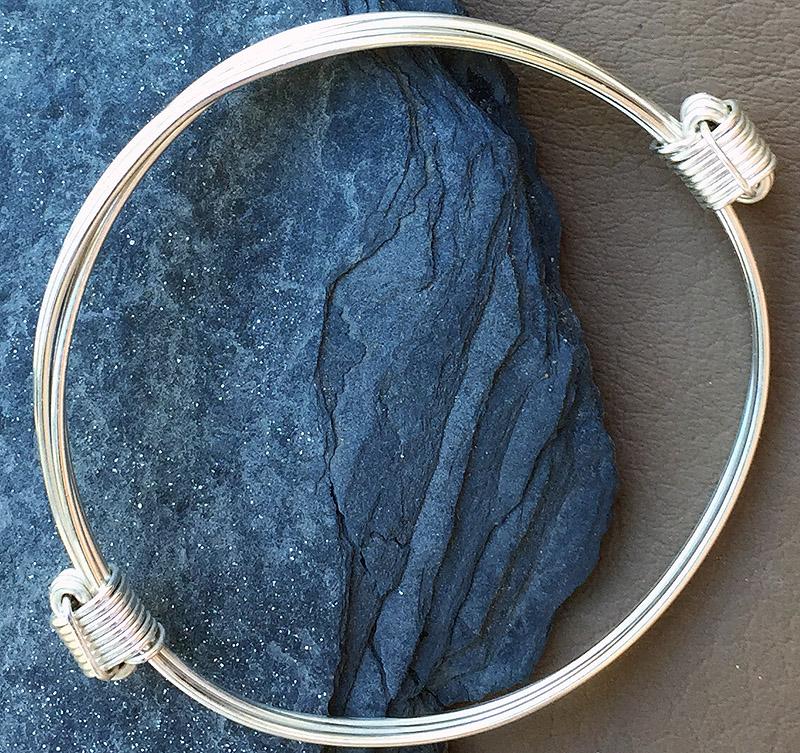 Simba303 silver 3 strand fine knot bracelet
