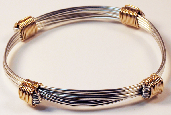 Silver Bracelet With 4 Gold Knots
