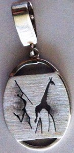 Silver with rock art figures panel pendant