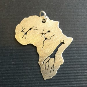 Gold Africa shaped pendant with rock art figures