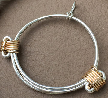 Silver and gold pendant in elephant hair knot style