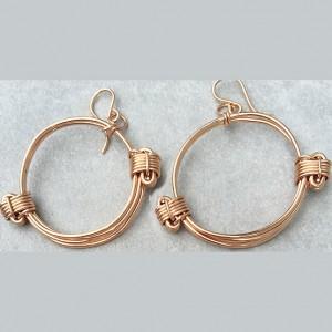 Rose gold knot hoop earrings