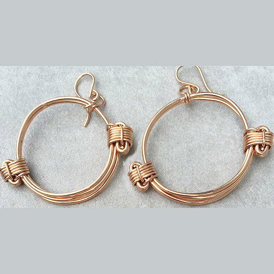 Rose gold knot hoop earrings
