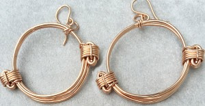 Rose gold earrings in elephant hair knot style