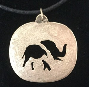 Bigger elephant cut out gold pendant