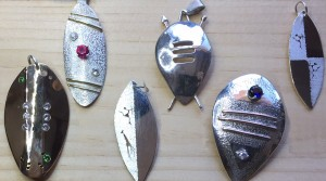 African warrior shield jewelry designs