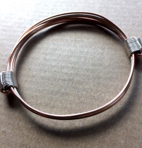 Copper and silver narrow bracelet in elephant hair knot style