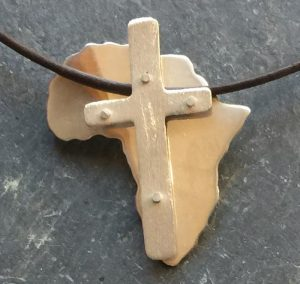 Gold africa pendant with silver shield