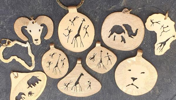 Gold rock art pendants