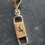 Small gold buck pendant