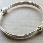 Combo silver and gold petite elephant hair knot bracelet
