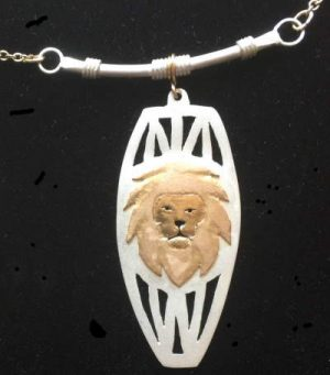 Gold lion head on sterling silver african necklace