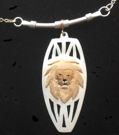 Gold lion head on sterling silver african pendant