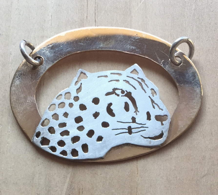 Leopard piereced silver and gold pendant
