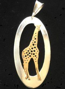 Gold hand pierced giraffe pendant