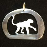 Silver monkey in cave frame
