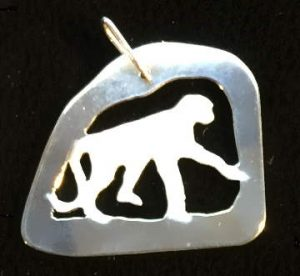 Monkey in cave pendant
