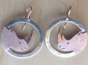Rose gold round rhino earrings