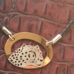Silver leopard necklace on gold