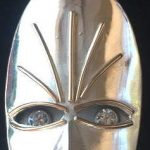 African mask pendant in silver and gold and diamonds