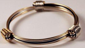 elegant silver gold and black bracelet