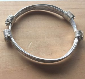 Closed view of silver lightweight Argentium 935 silver bangle