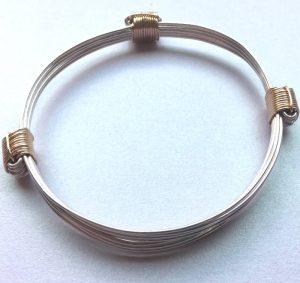 silver and sliding gold knots bangle