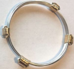 gold and silver slide knots bracelet